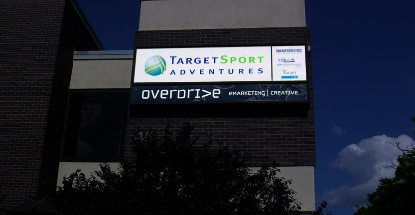 Night View of Target Sport Adventures Exterior Illuminated Sign
