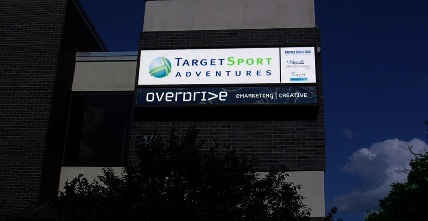 Night View of Target Sport Adventures Storefront Light Box