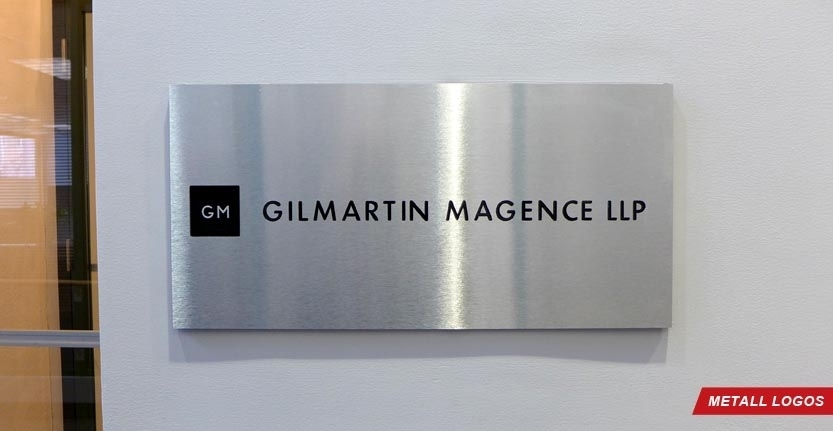 Close View of Gilmartin Magence Metal Lobby Logo